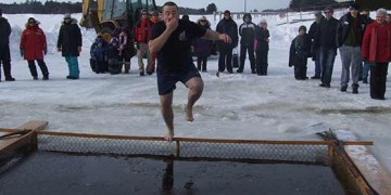 man jumping into polar dip blind river