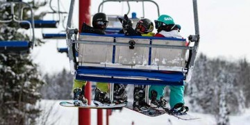 snowboarders on lift at searchmont resort