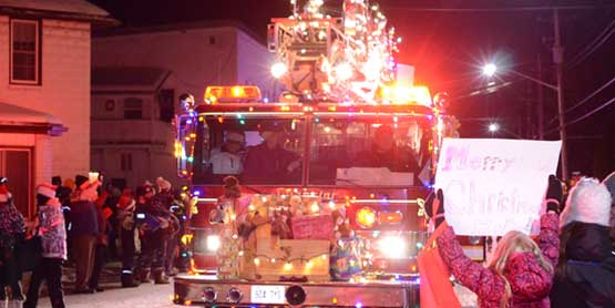 firetruck decorted with christmas lights