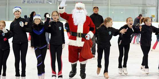 figure skaters with Santa