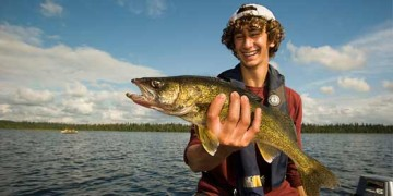 youth angler with walleye